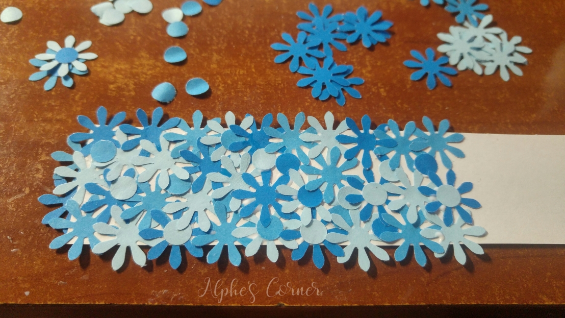 Simple DIY flower bookmarks - glueing the flowers onto a piece of paper