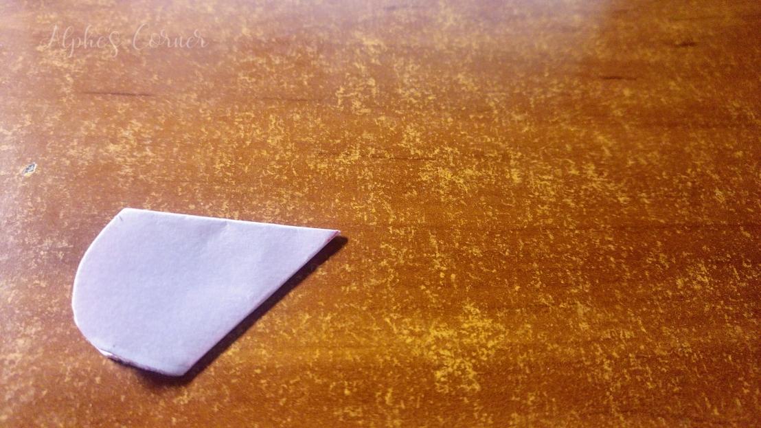 Folded piece of paper cut to petal shape