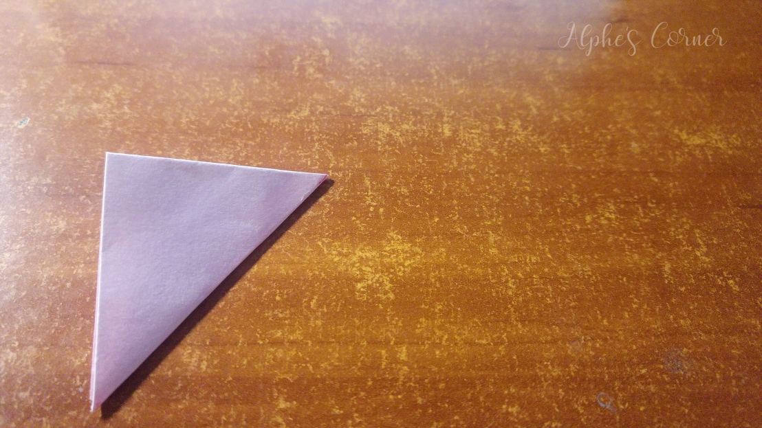 Twice folded square of paper