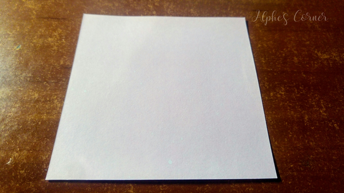 A square piece of white paper