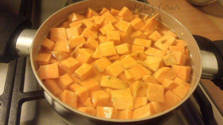 Chopped up sweet potato in water