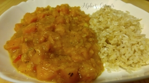 Spicy sweet potato stew on a plate, with rice