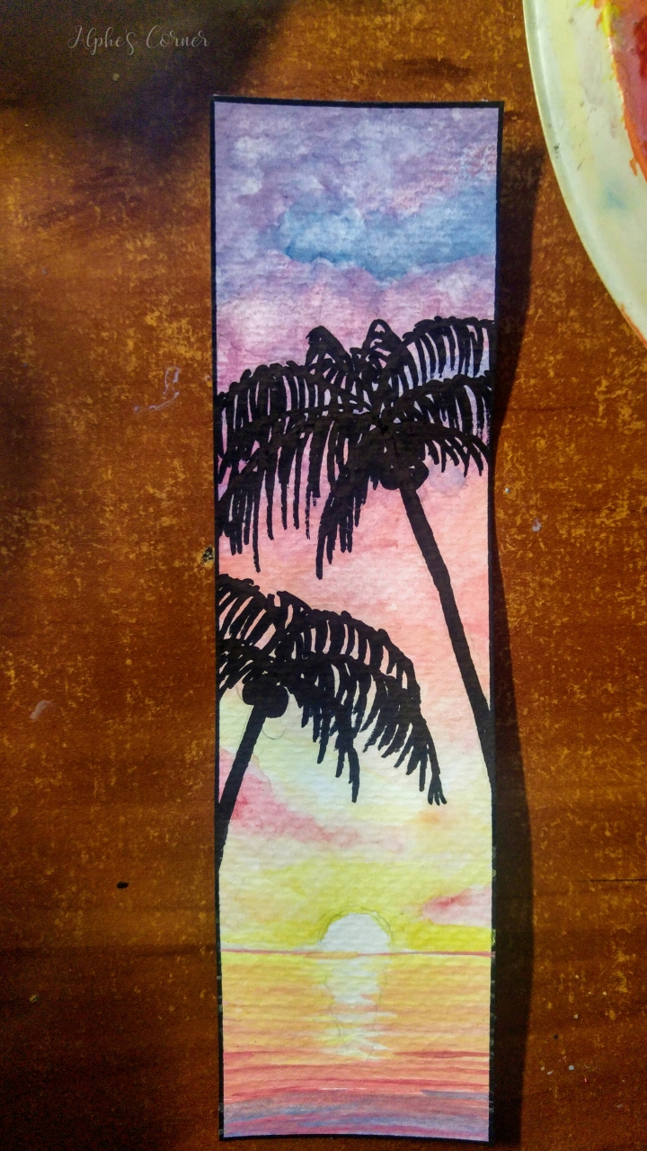A watercolour bookmark - sunset, palm trees and the sea - completed