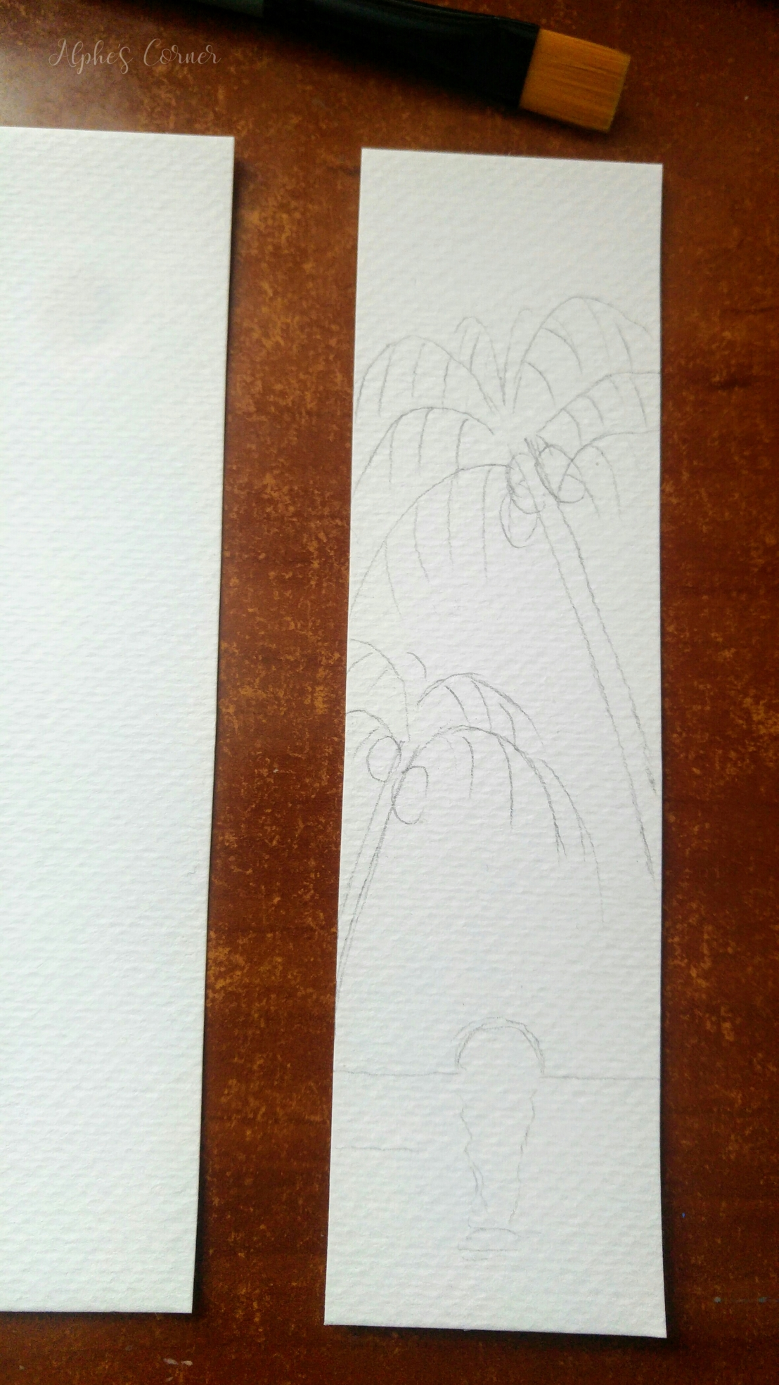Sketching the sunset and palm trees on a bookmark