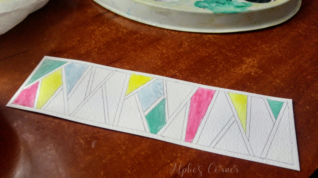 Filling the geometric pattern with watercolours