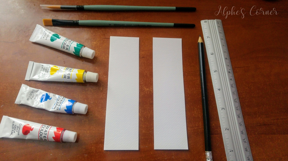 Blank bookmark, a pencil, ruler and watercolour paints
