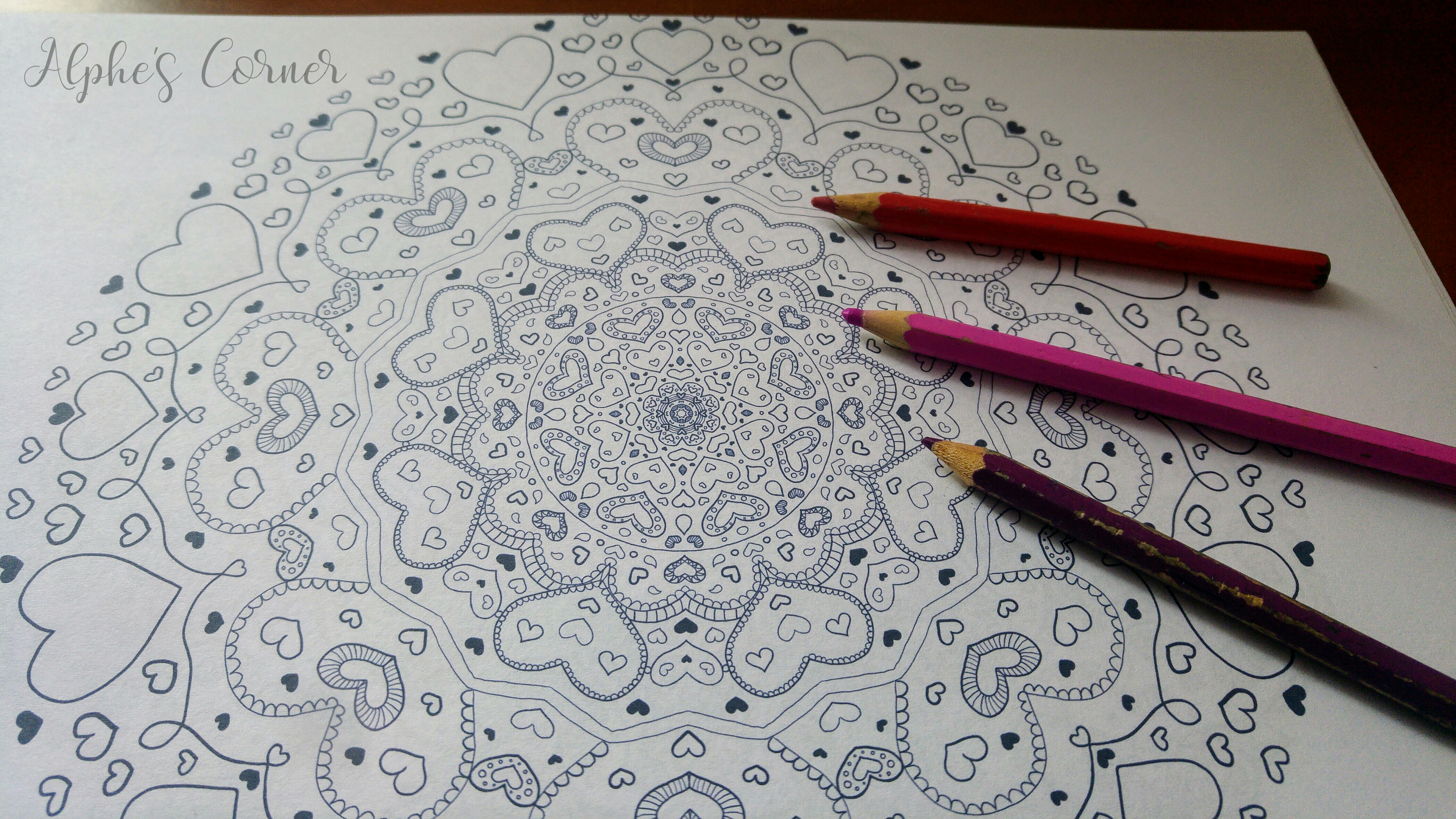 Mandala colouring page and coloured pencils