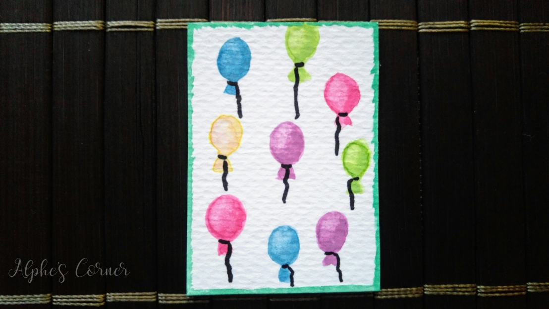 A tag with watercolour balloons