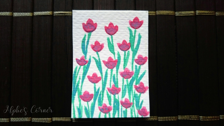 A small paper tag with watercolour tulips