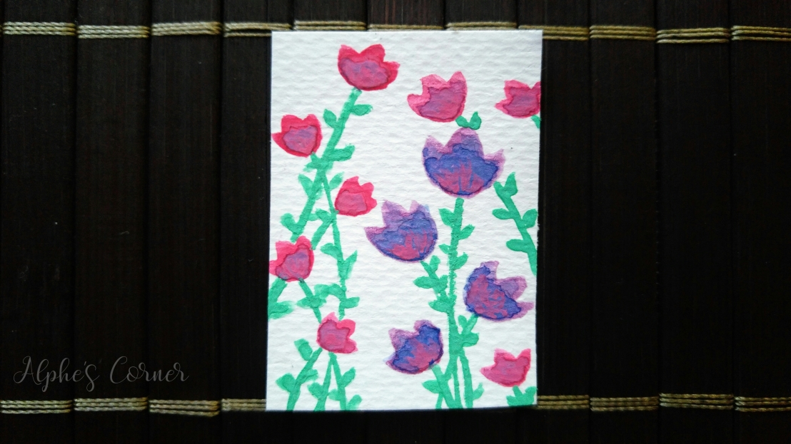 A small tag with purple and pink tulips