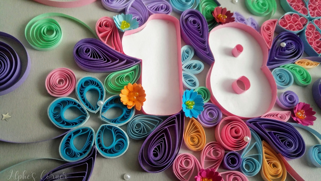 A floral number quilling card - 18th birthday