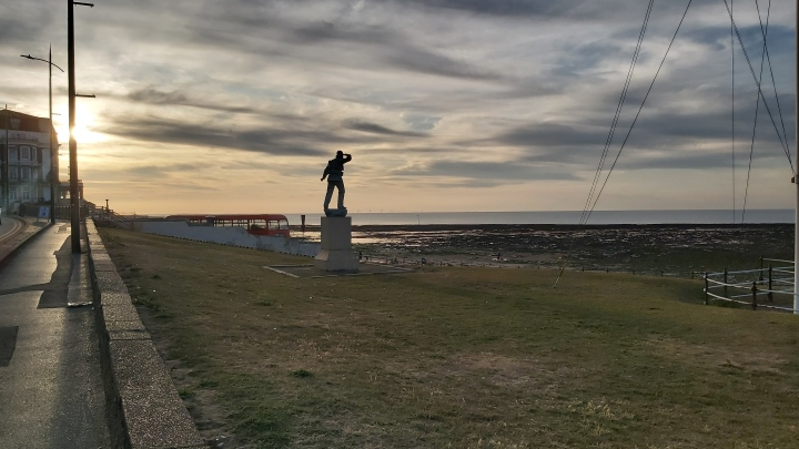 A mysterious statue on the beach in Margate, at sunset