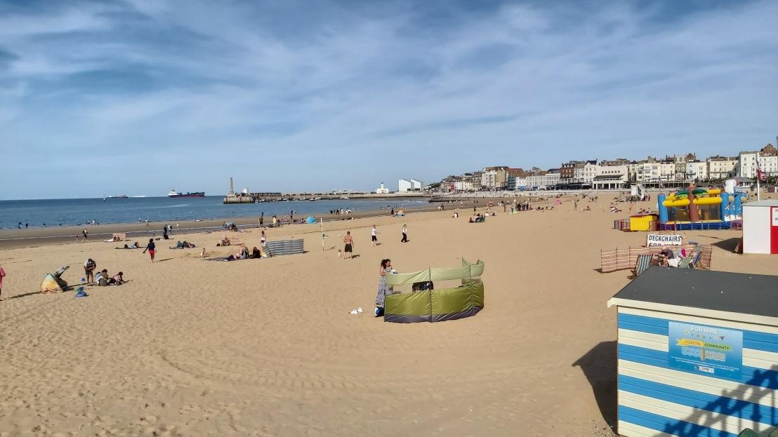 The sandy beach in Margate, people sunbathing