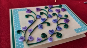 Small purple flowers - handmade quilled card