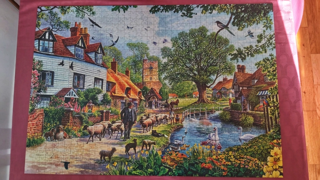 A completed jigsaw puzzle - village