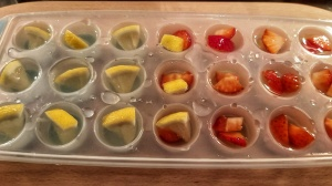 Lemonade strawberry ice cubes in the tray