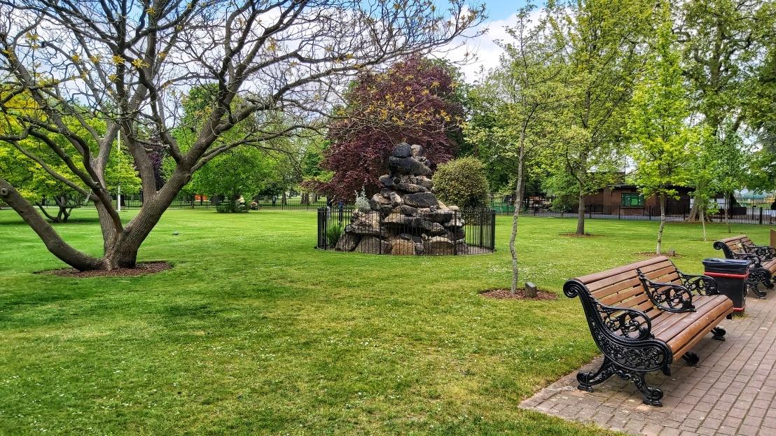 London parks - West Ham Park - pile of rocks statue