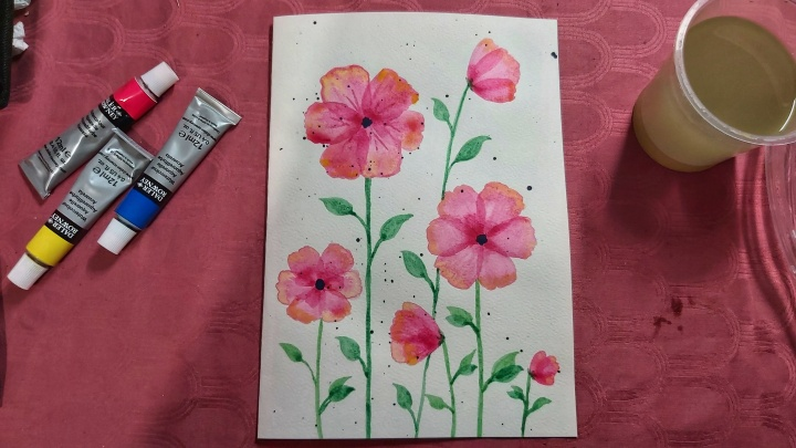 A birthday card with neon pink watercolour poppies