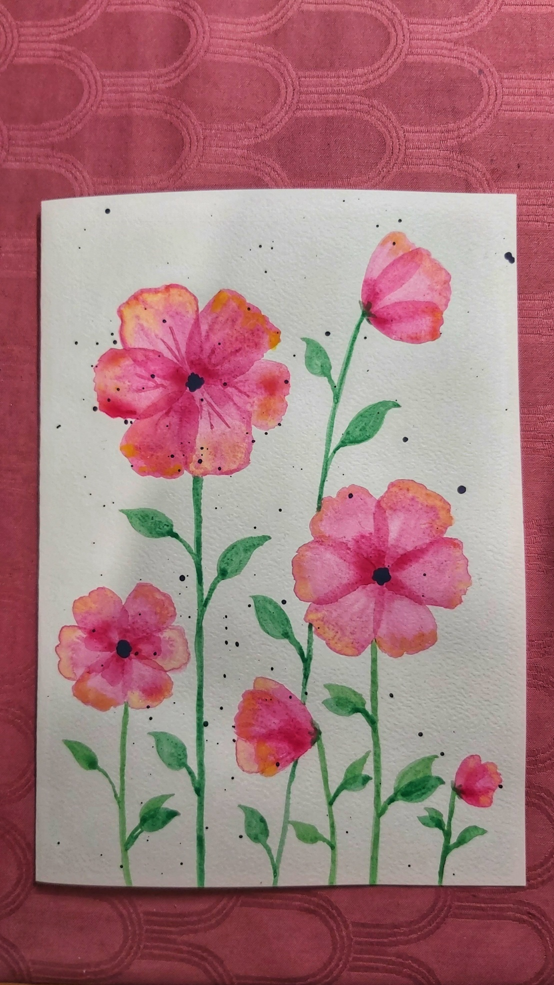 A completed birthday card with neon pink watercolour poppies