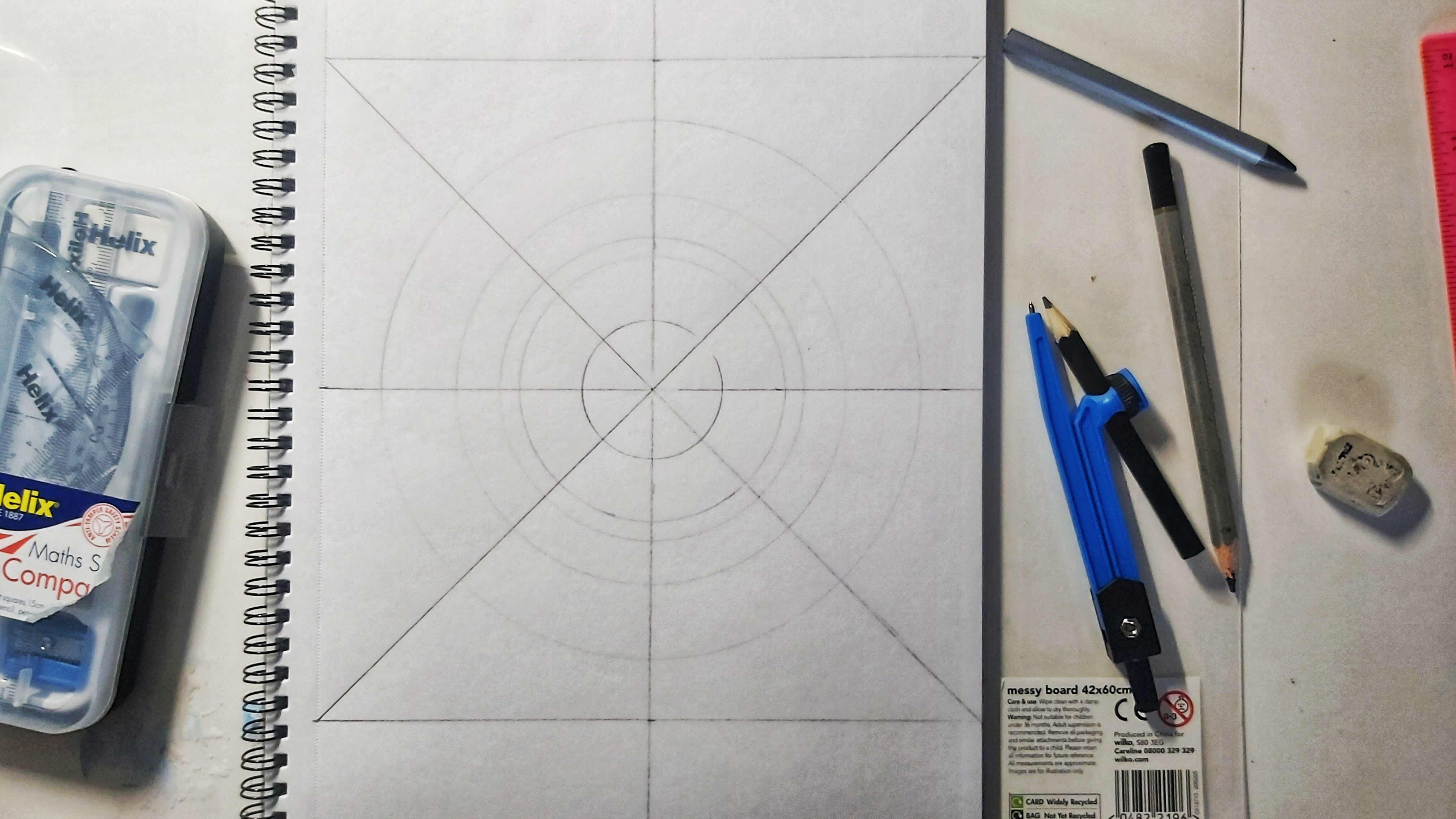 A square divided into 8 pieces and a few circles, pencil