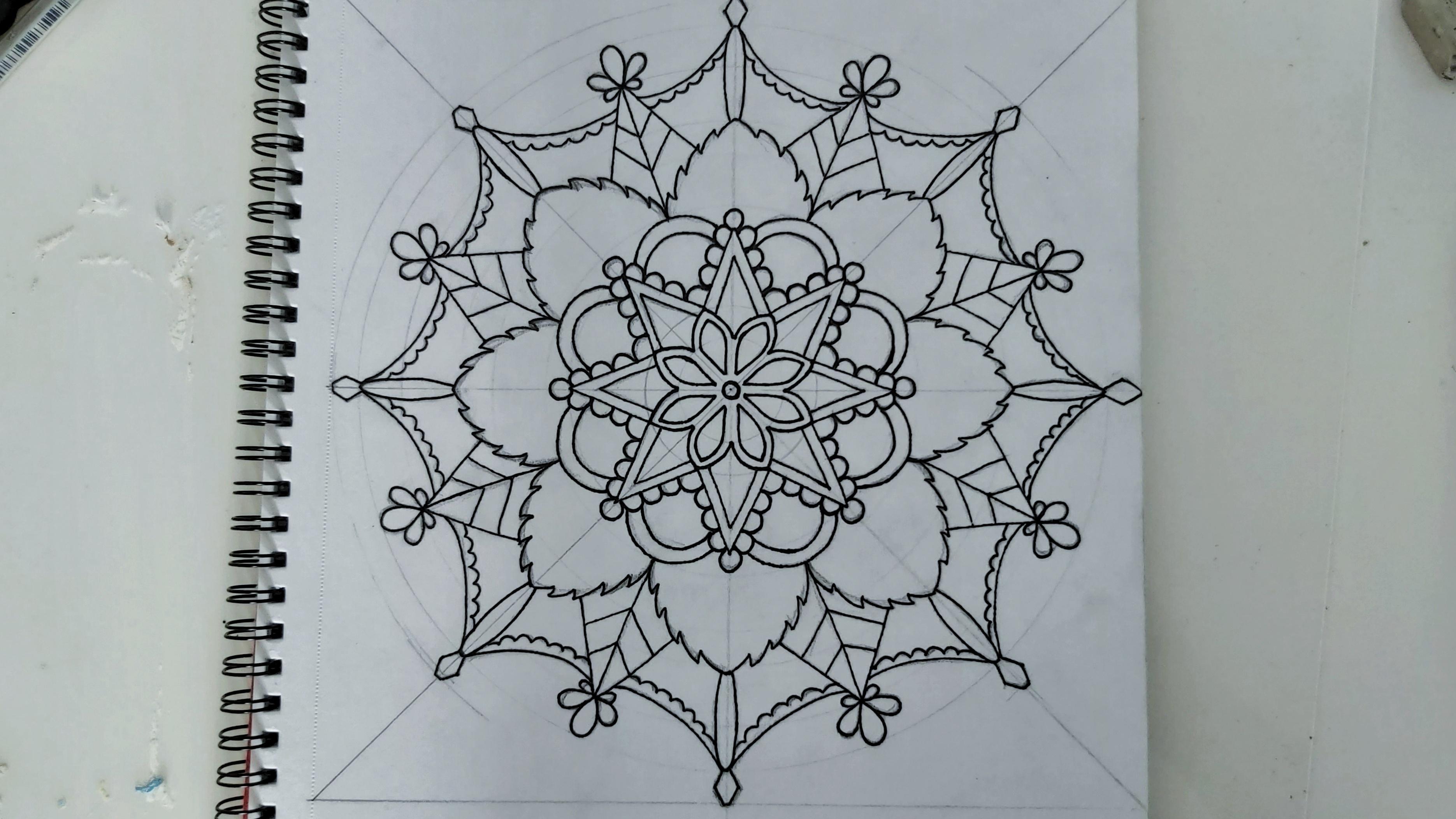 Mandala in black liner pen