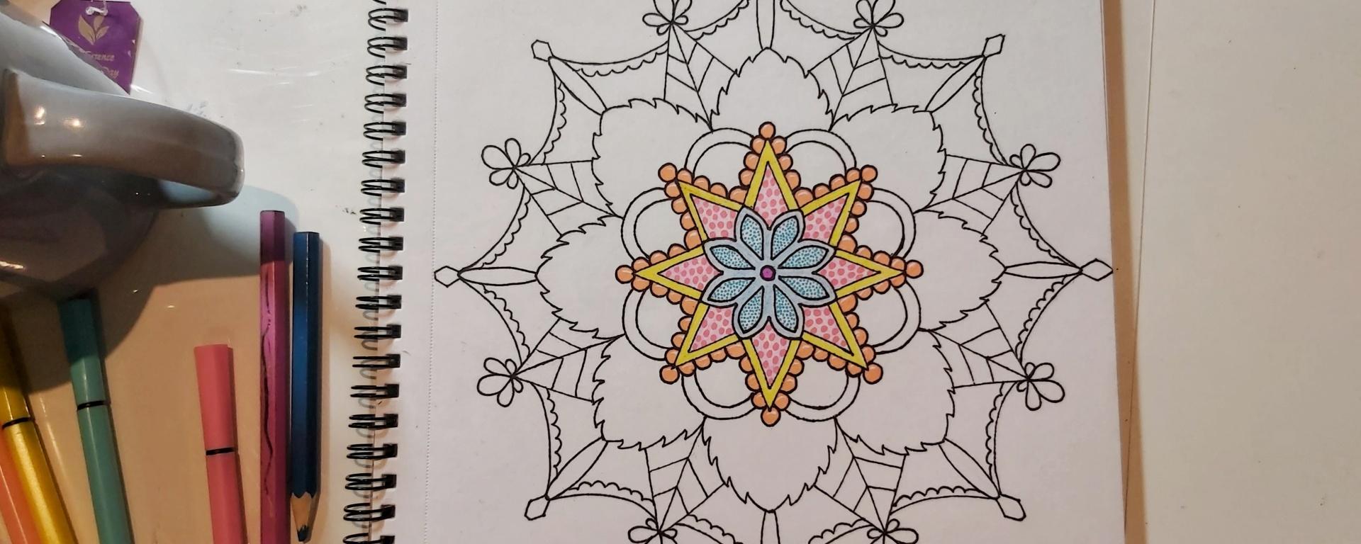Mandala in black liner pen, colour in inner levels