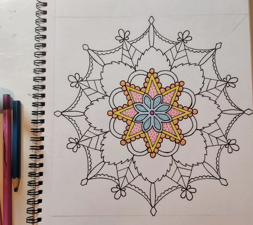 Mandala in black liner pen, colour in inner levels