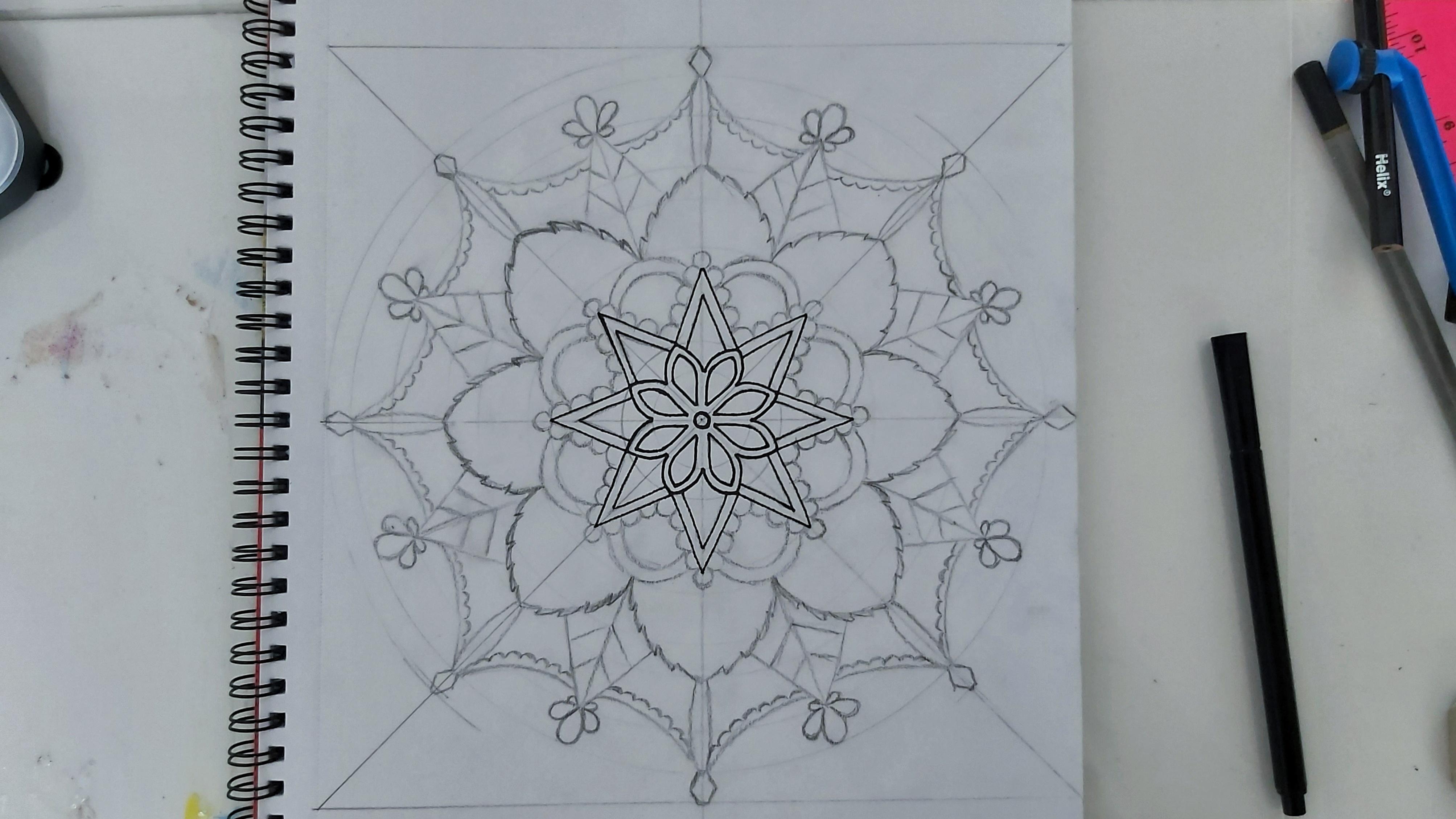 The first inner levels in black liner pen, mandala