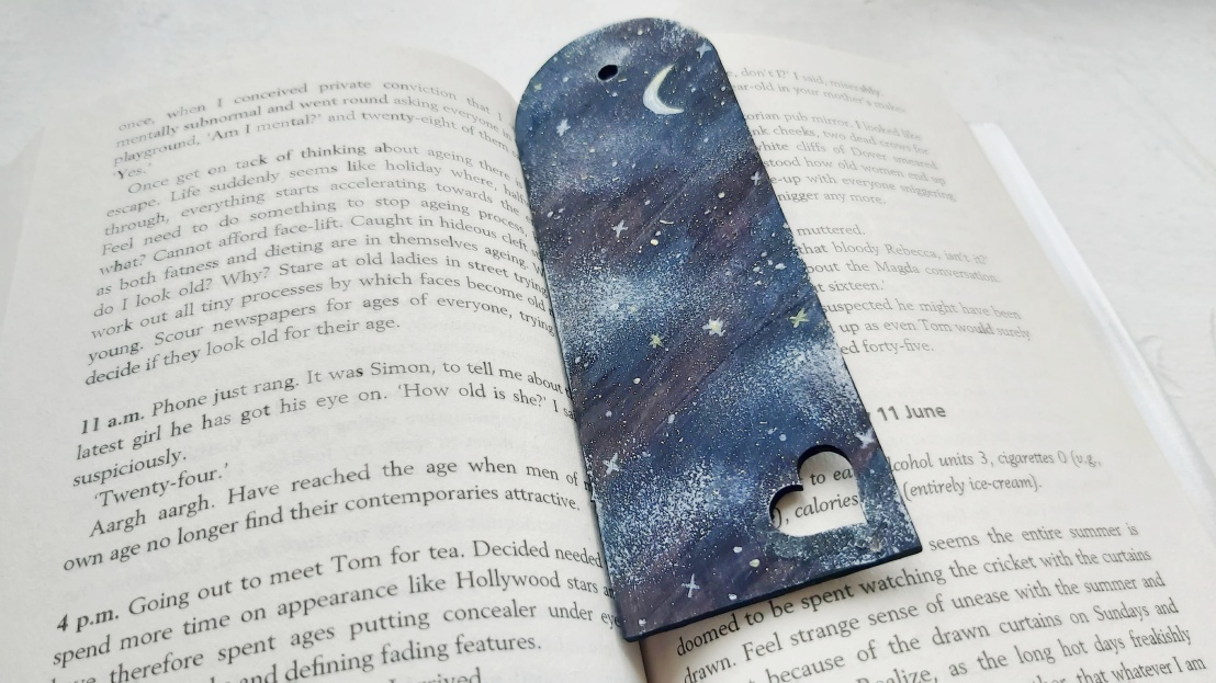 Midnight wooden bookmark - in a book
