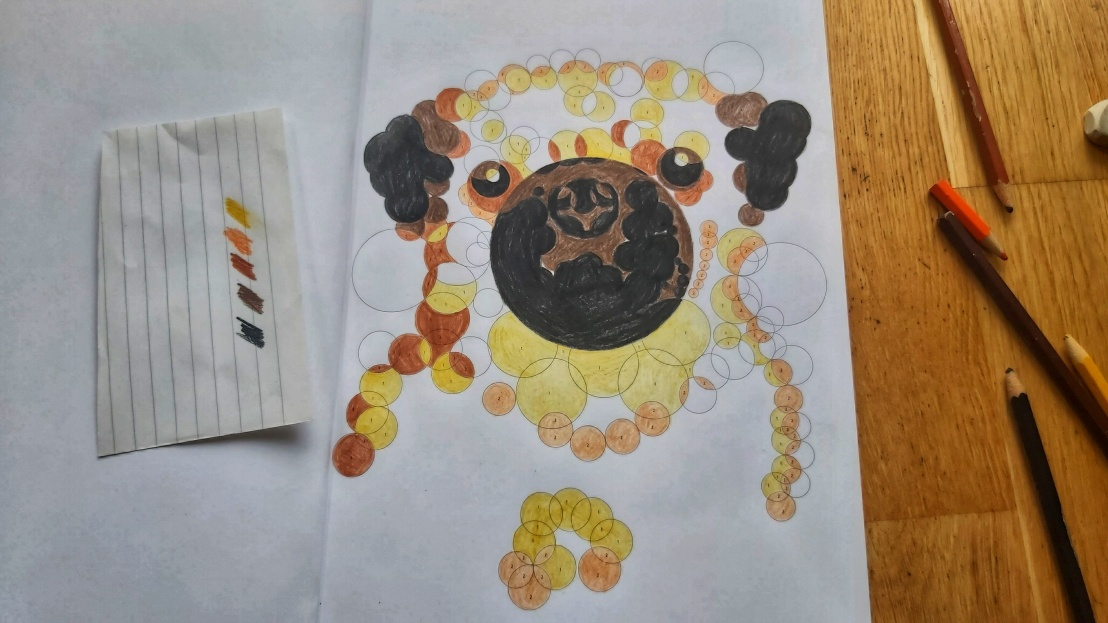 A finished numbers colouring book - orange and brown pug