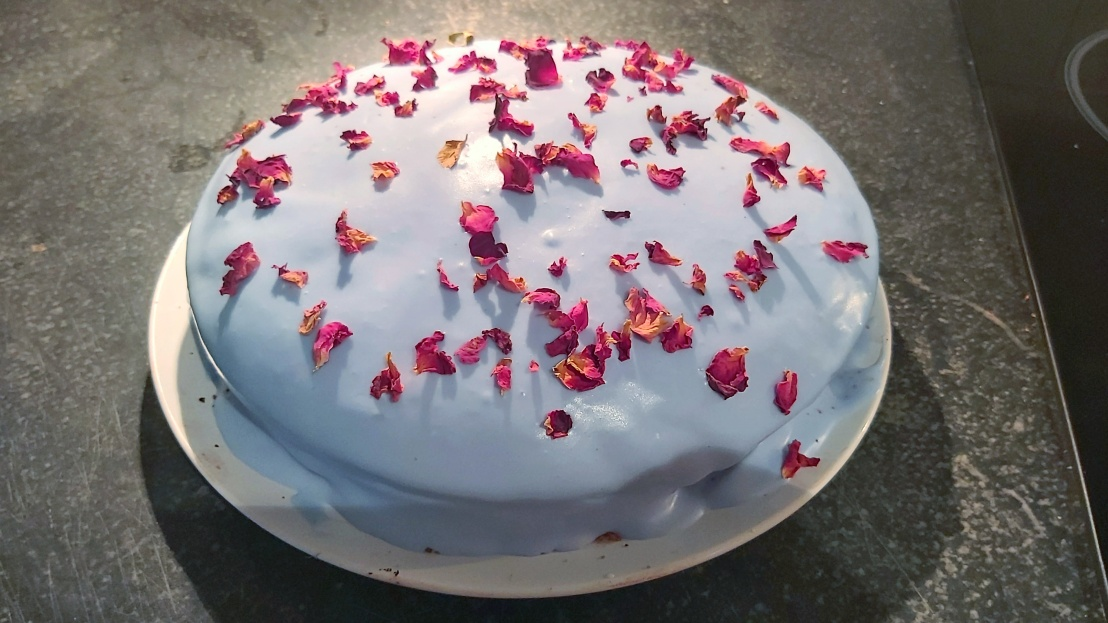 Red velvet cake with blue, strawberry frosting