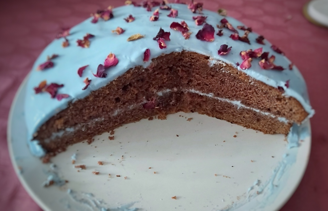 Red velvet cake with blue, strawberry frosting - sliced into