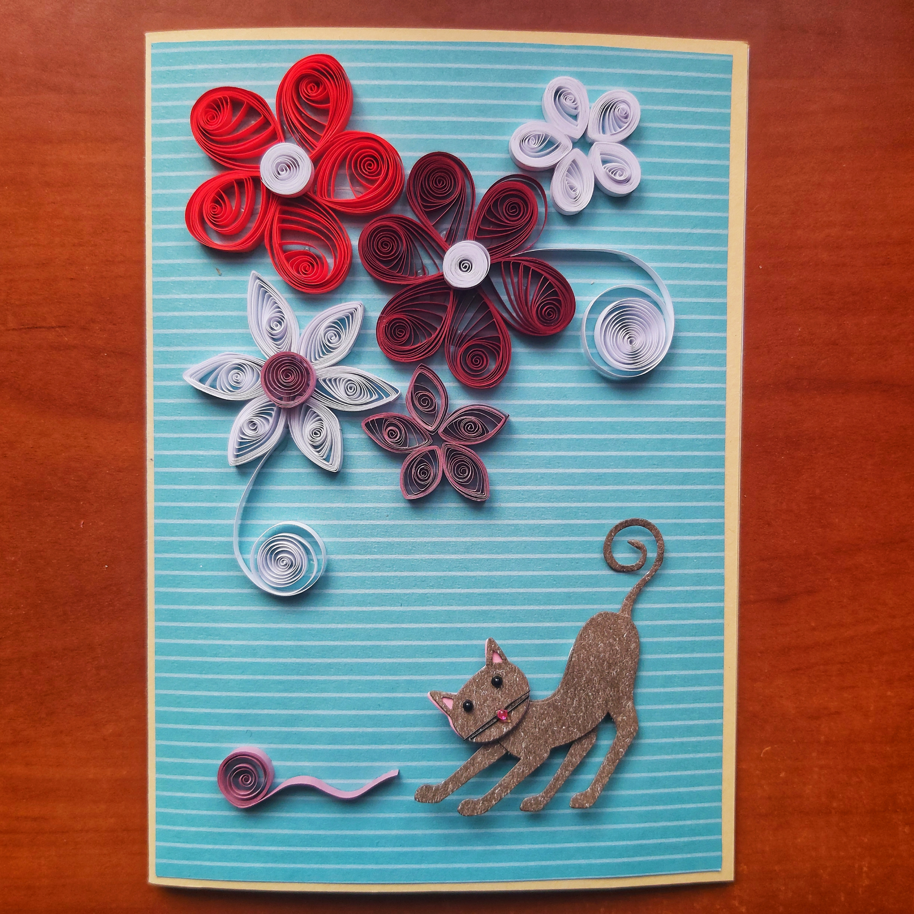 Handmade quilling card - cat with flowers
